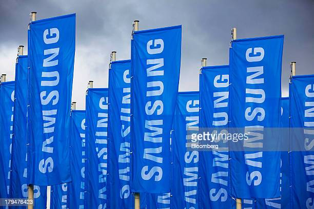 The Samsung Electronics Co Ltd logo sits on banners flying outside the venue ahead of the opening of the IFA consumer electronics show in Berlin...