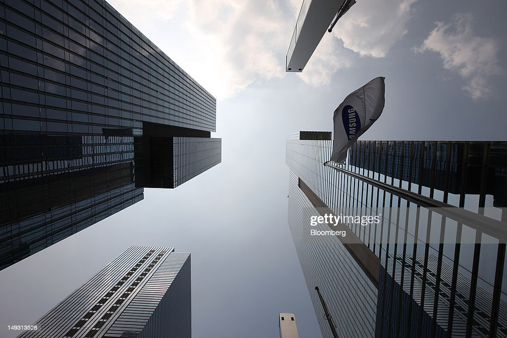 The Samsung Electronics Co. Seocho office building, right, stand in Seoul, South Korea, on Thursday, July 26, 2012. Samsung, the world's largest maker of TVs and mobile phones, reported second-quarter profit that missed analysts' estimates after chip prices weakened and smartphone output failed to keep up with demand. Photographer: SeongJoon Cho/Bloomberg via Getty Images