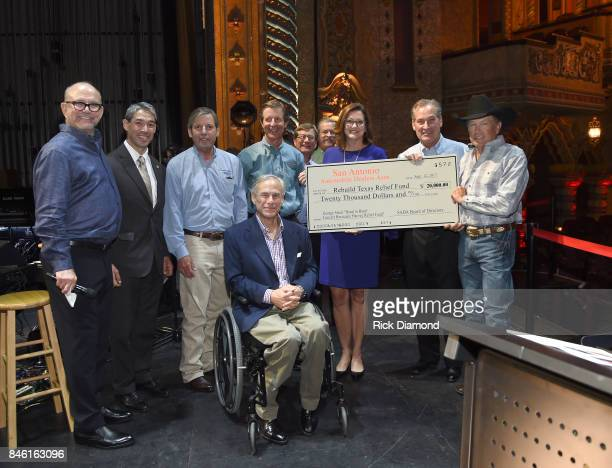 The San Antonio Auto Dealers Association presents a $20000 check to the Rebuild Texas Relief Fund to Founder/CEO of Messina Touring Group Louis...