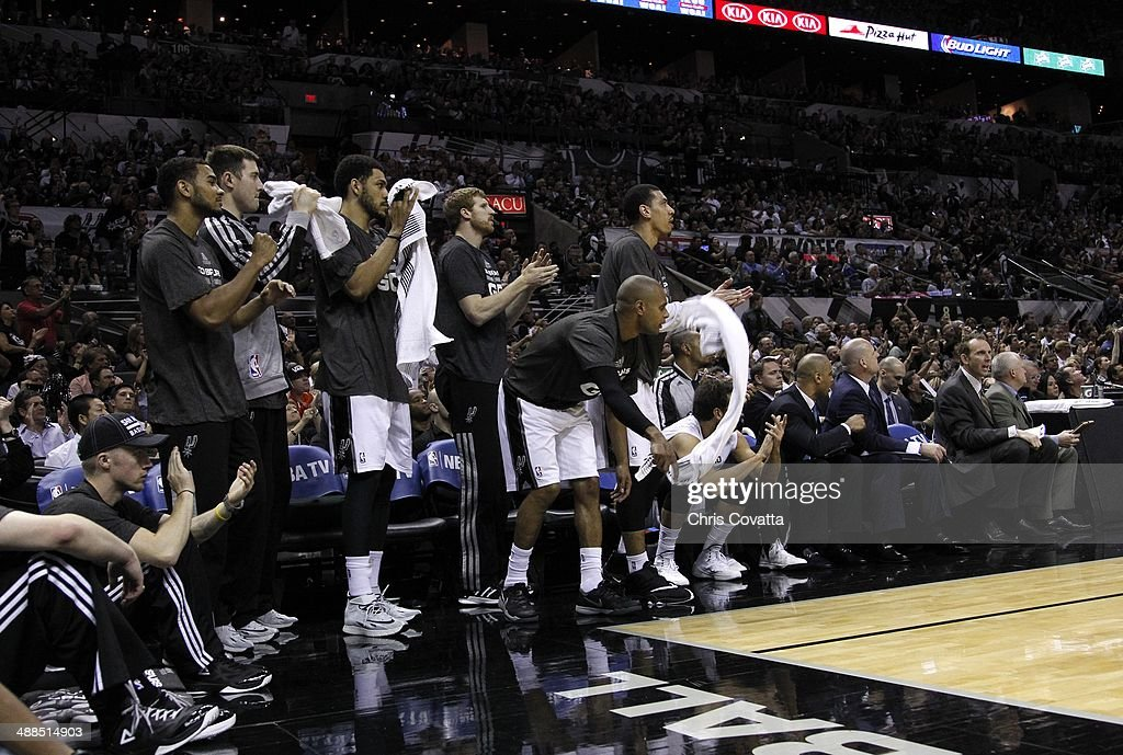 The San Antonio Spurs bench cheers as their team takes a big lead against the Portland Trail Blazers in Game One of the Western Conference Semifinals during the 2014 NBA Playoffs at the AT&T Center on May 6, 2014 in San Antonio, Texas.