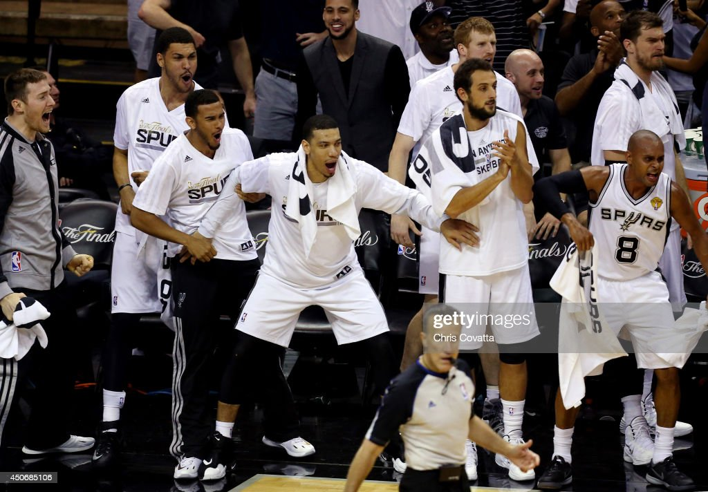 The San Antonio Spurs bench reacts against the Miami Heat during Game Five of the 2014 NBA Finals at the AT&T Center on June 15, 2014 in San Antonio, Texas.