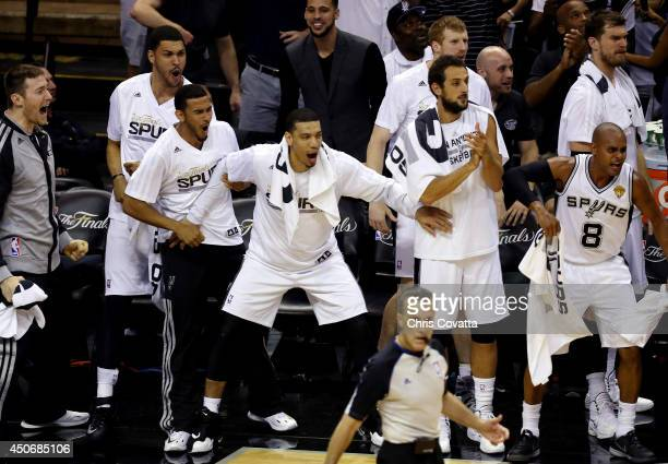 The San Antonio Spurs bench reacts against the Miami Heat during Game Five of the 2014 NBA Finals at the ATT Center on June 15 2014 in San Antonio...