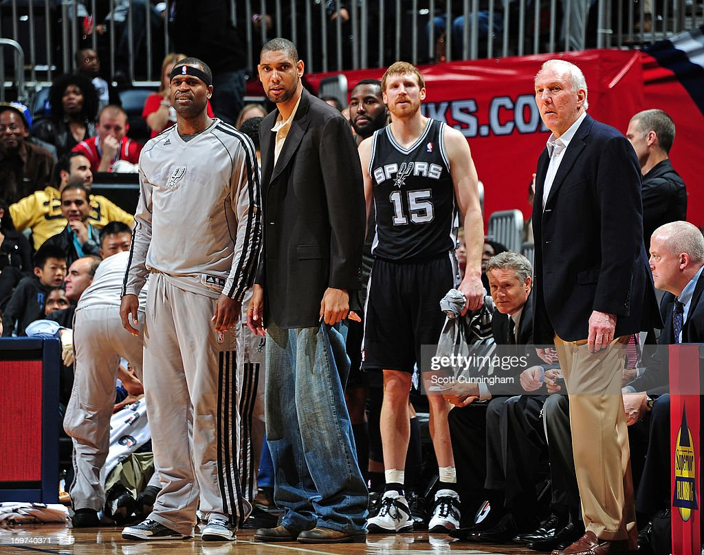 The San Antonio Spurs bench reacts to a play against the Atlanta Hawks on January 19, 2013 at Philips Arena in Atlanta, Georgia.
