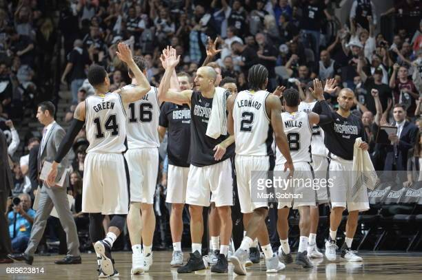 The San Antonio Spurs celebrate against the Memphis Grizzlies during Game Two of the Western Conference Quarterfinals of the 2017 NBA Playoffs on...