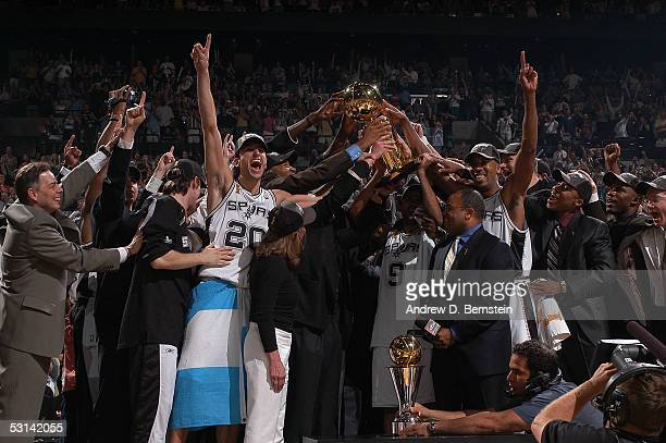 The San Antonio Spurs celebrate winning the 2005 NBA Championship with the Larry O'Brien trophy following their 8174 win against the Detroit Pistons...