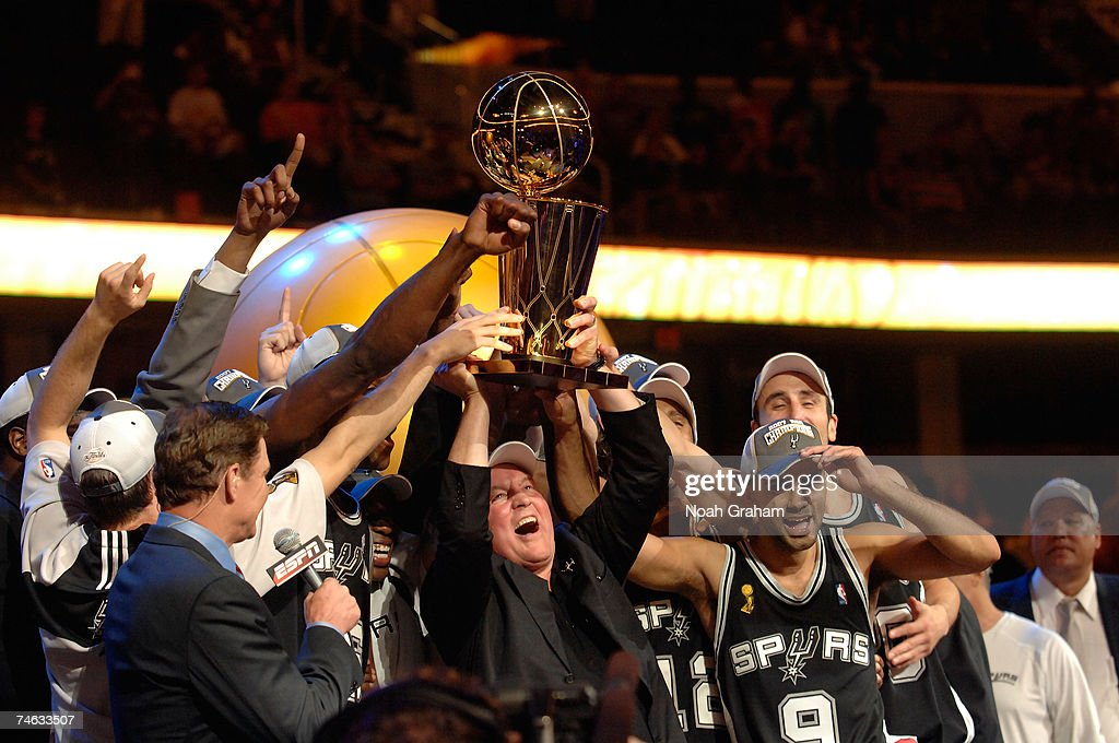 The San Antonio Spurs celebrate with the Larry O'Brien NBA Championship Trophy after their 83-82 win against the Cleveland Cavaliers in Game Four of the NBA Finals at the Quicken Loans Arena on June 14, 2007 in Cleveland, Ohio.