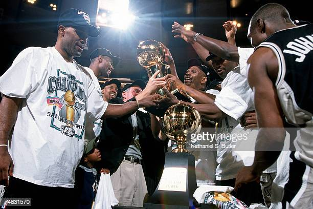 The San Antonio Spurs celebrate with the Larry O'Brien trophy following Game Five of the 1999 NBA Finals at Madison Square Garden on June 25 1999 in...
