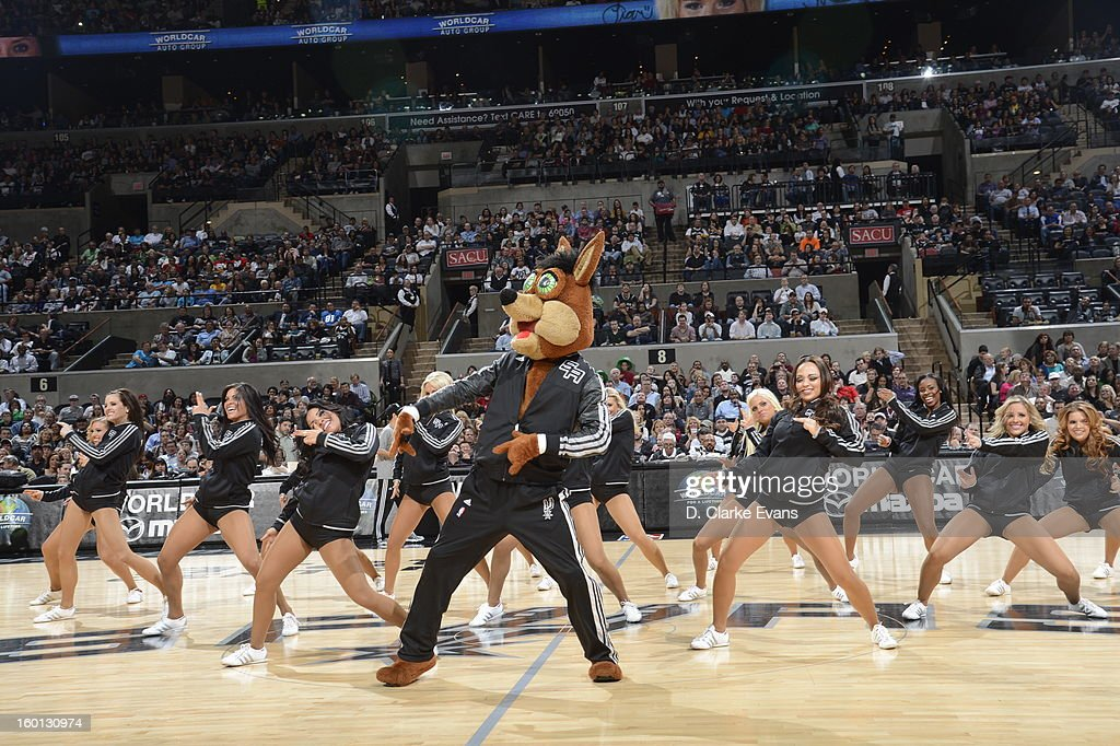 The San Antonio Spurs Dance Team and their mascot, The'Coyote,' perform during a break in play against the Phoenix Suns on January 26, 2013 at the AT&T Center in San Antonio, Texas.