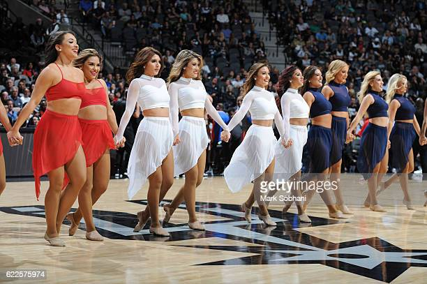 The San Antonio Spurs dance team performs at halftime during the game against the Detroit Pistons on November 11 2016 at the ATT Center in San...