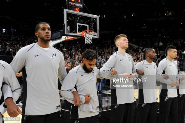The San Antonio Spurs honor the National Anthem before the game against the Minnesota Timberwolves on October 18 2017 at the ATT Center in San...