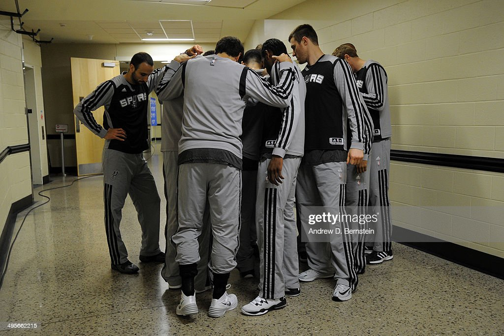 The San Antonio Spurs huddle before Game Four of the Western Conference Finals against the Oklahoma City Thunder during the 2014 NBA Playoffs on May 27, 2014 at the Chesapeake Energy Arena in Oklahoma City,Oklahoma.
