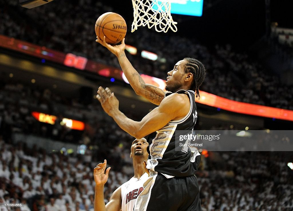The San Antonio Spurs' Kawhi Leonard goes to the basket against the Miami Heat's Chris Bosh in Game 7 of the NBA Finals at the AmericanAirlines Arena in Miami, Florida, on Thursday, June 20, 2013.
