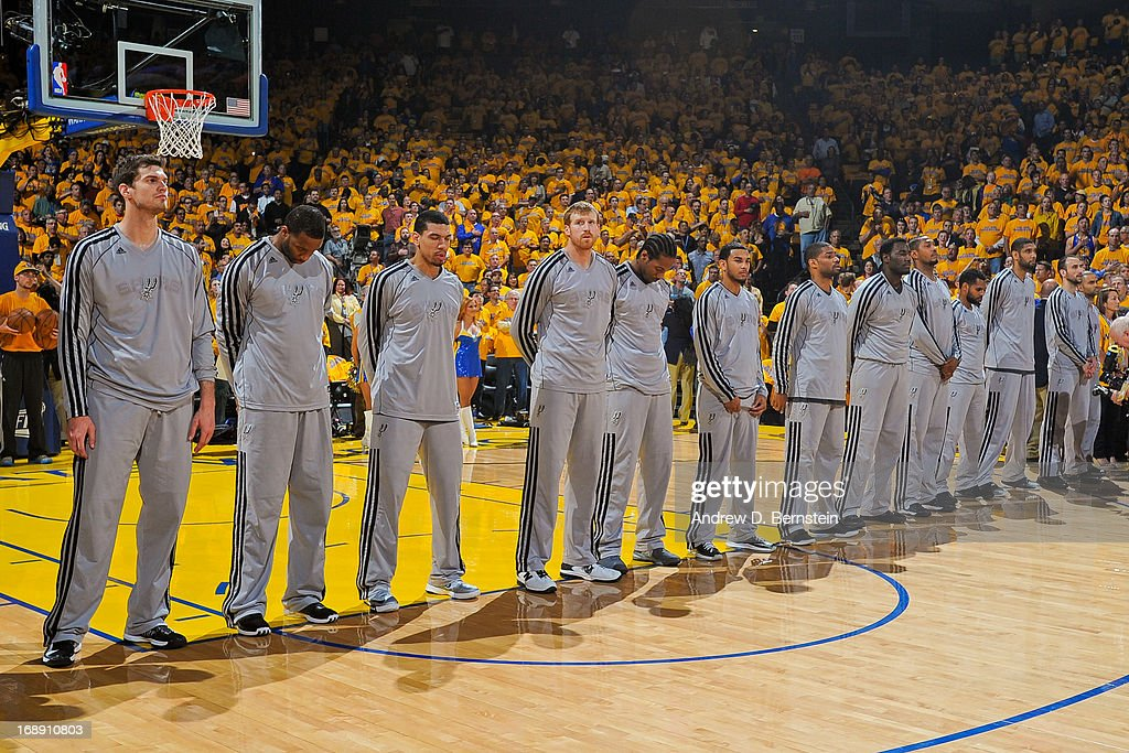 The San Antonio Spurs listen to the National Anthem before playing against Golden State Warriors in Game Six of the Western Conference Semifinals during the 2013 NBA Playoffs on May 16, 2013 at Oracle Arena in Oakland, California.