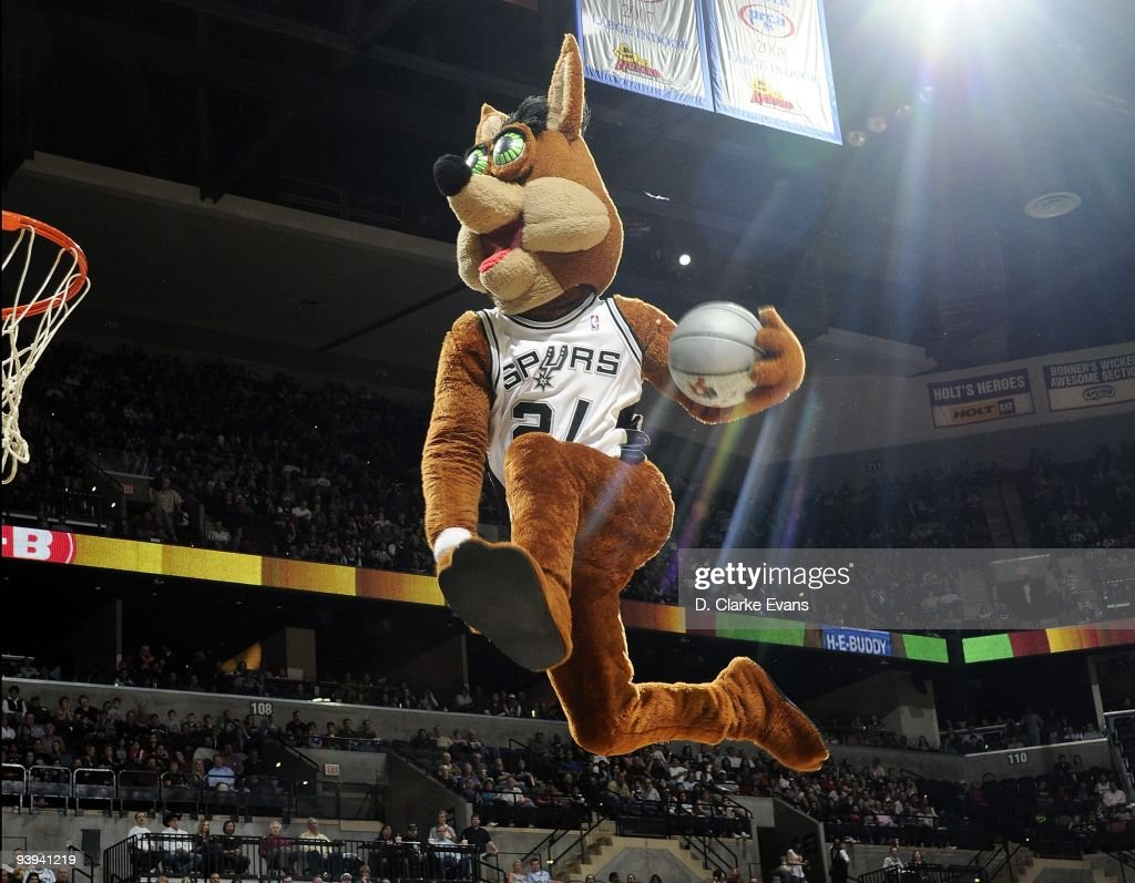 The San Antonio Spurs mascot 'The Coyote' performs a power dunk during a break in the action against the Milwaukee Bucks at ATT Center on November 23...