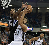 The San Antonio Spurs' Tim Duncan pulls down a rebound ahead of the Sacramento Kings' Jason Thompson in the first quarter on Friday Feb 27 at Sleep...