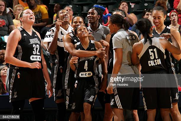 The San Antonio Stars celebrate their victory against the Indiana Fever after the game during their WNBA game at Bankers Life Fieldhouse on July 1...
