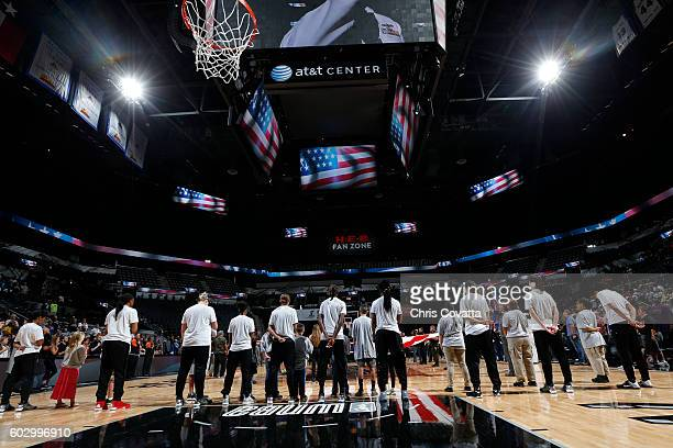 The San Antonio Stars stand for the national anthem before the game against the Minnesota Lynx on September 11 2016 at ATT Center in San Antonio...