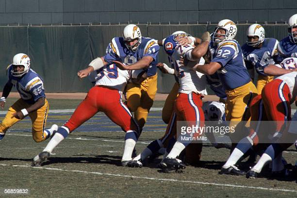 The San Diego Chargers battle against the Denver Broncos at the line of scrimmage during a game circa 1960's
