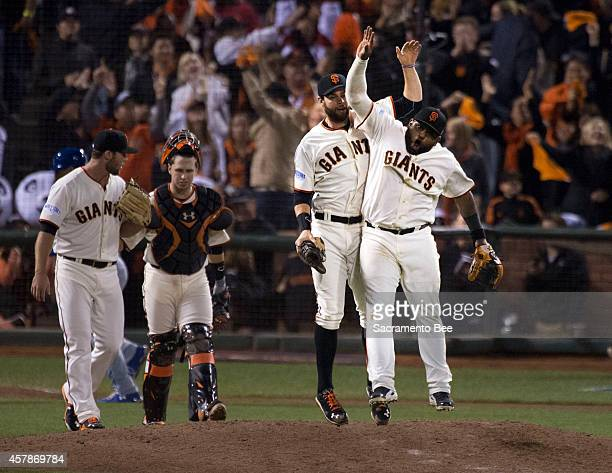 The San Francisco Giants' Brandon Belt and Pablo Sandoval right celebrate after an 114 win against the Kansas City Royals during Game 4 of the World...