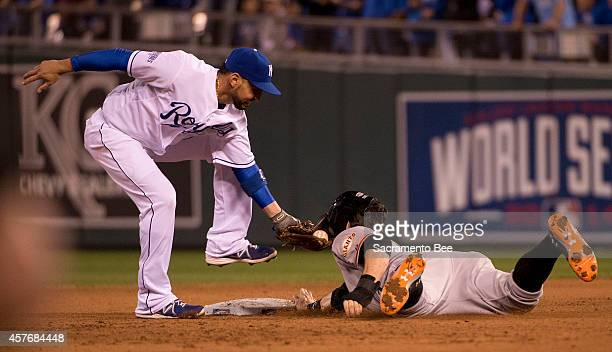 The San Francisco Giants' Brandon Belt right is tagged out at second base by Kansas City Royals second baseman Omar Infante in the fourth inning of...