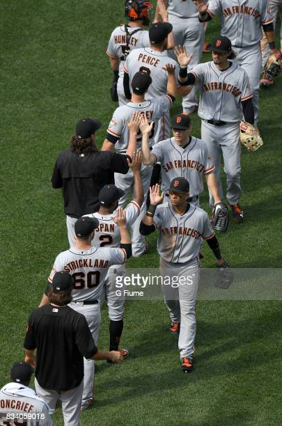 The San Francisco Giants celebrate after a 42 victory against the Washington Nationals during Game 1 of a doubleheader at Nationals Park on August 13...