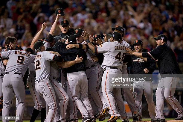 The San Francisco Giants celebrate after defeating the Texas Rangers to win the World Series at Rangers Ballpark in Arlington Texas on Monday...