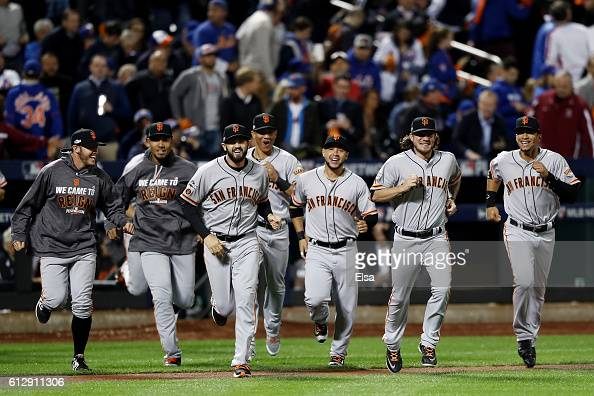 The San Francisco Giants celebrate after they defeated the New York Mets 30 to win the National League Wild Card game at Citi Field on October 5 2016...