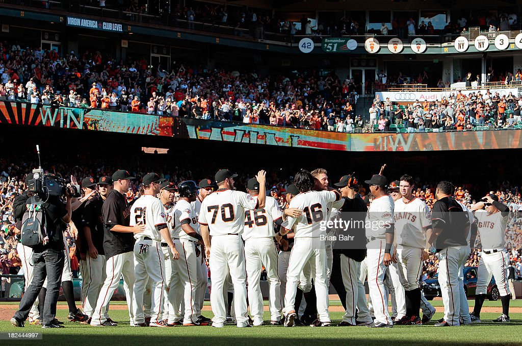 The San Francisco Giants celebrate at the mound after Hunter Pence #8 hit a walk-off RBI single to center field to beat the San Diego Padres 7-6 in nine innings at AT&T Park on September 29, 2013 in San Francisco, California.