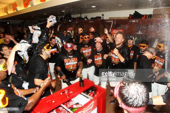The San Francisco Giants celebrate in the locker room after their 3 to 2 win over the Washington Nationals in Game Four of the National League...