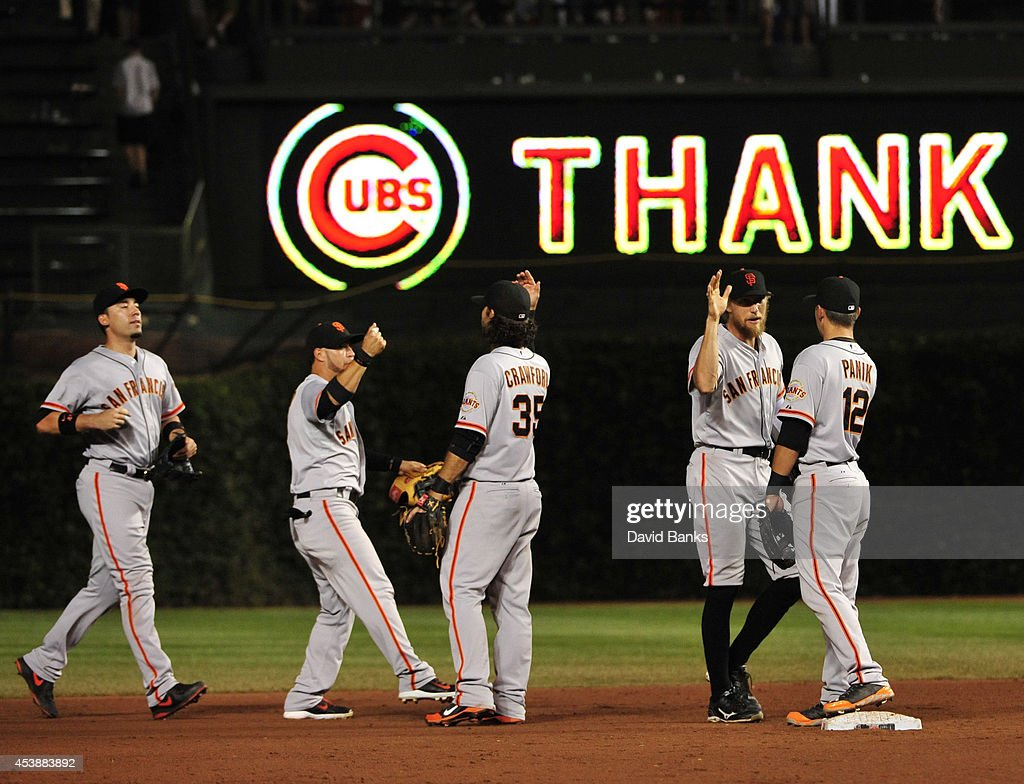 The San Francisco Giants celebrate their win against the Chicago Cubs on August 20, 2014 at Wrigley Field in Chicago, Illinois. The San Francisco Giants defeated the Chicago Cubs 8-3.