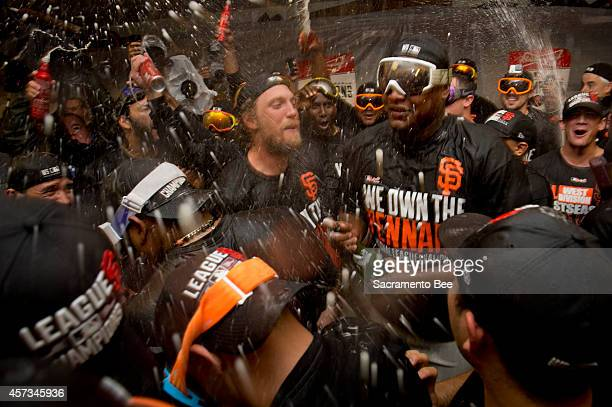 The San Francisco Giants' Hunter Pence leads the team in a cheer during the celebration in the locker room following a seriesclinching 63 win in Game...