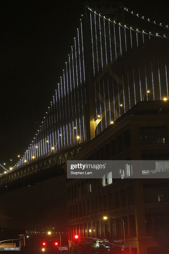 The San Francisco-Oakland Bay Bridge is illuminated with artist Leo Villareal's Bay Lights sculpture on March 5, 2013 in San Francisco, California. Designed by artist Leo Villareal, the Bay Lights is the world's largest LED light sculpture, spanning 1.8 miles long and 500 feet high with 25,000 individual LED lights. The installation will be on display daily from dusk to 2 a.m. for the next two years