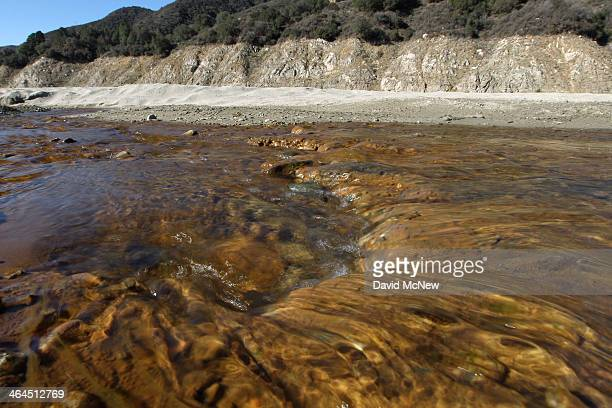 The San Gabriel River moves through the dry upper reaches of San Gabriel Reservoir in the Angeles National Forest on January 22 2014 in near Azusa...