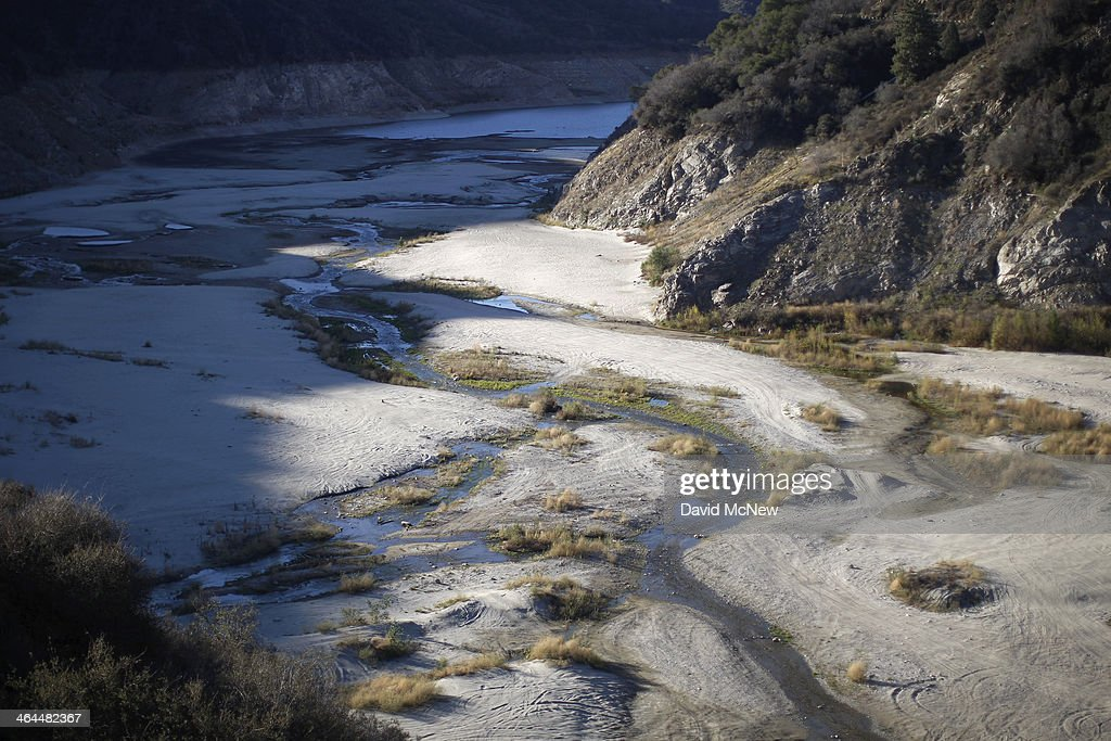 The San Gabriel River winds through the dry upper reaches of San Gabriel Reservoir in the Angeles National Forest on January 22, 2014 in near Azusa, California. Now in its third straight year of drought conditions, California is experiencing its driest year on record, dating back 119 years, and reservoirs throughout the state have low water levels. Unseasonable dangerous wildfire weather helped spread the nearby 1,952-acre Colby Fire which firefighters are about to contain but not before it destroyed five homes, damaged 17 others and injured six people. Gov. Jerry Brown officially declared a drought emergency on Friday to speed up assistance to local governments, streamline water transfers and potentially ease environmental protection requirements for dam releases.