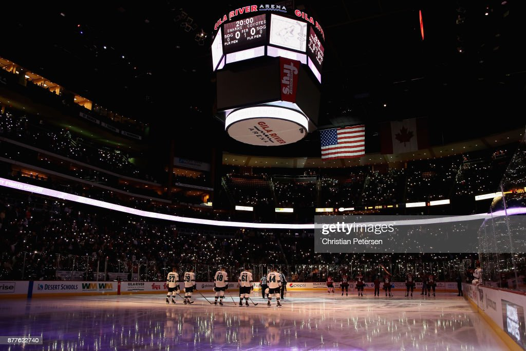 The San Jose Sharks and the Arizona Coyotes stand attended for the national anthem before the NHL game at Gila River Arena on November 22, 2017 in Glendale, Arizona.