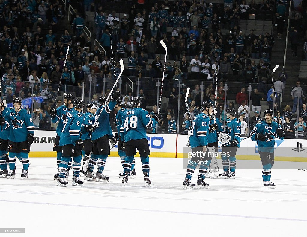 The San Jose Sharks celebrate a victory against the Calgary Flames during an NHL game on October 19, 2013 at SAP Center in San Jose, California.