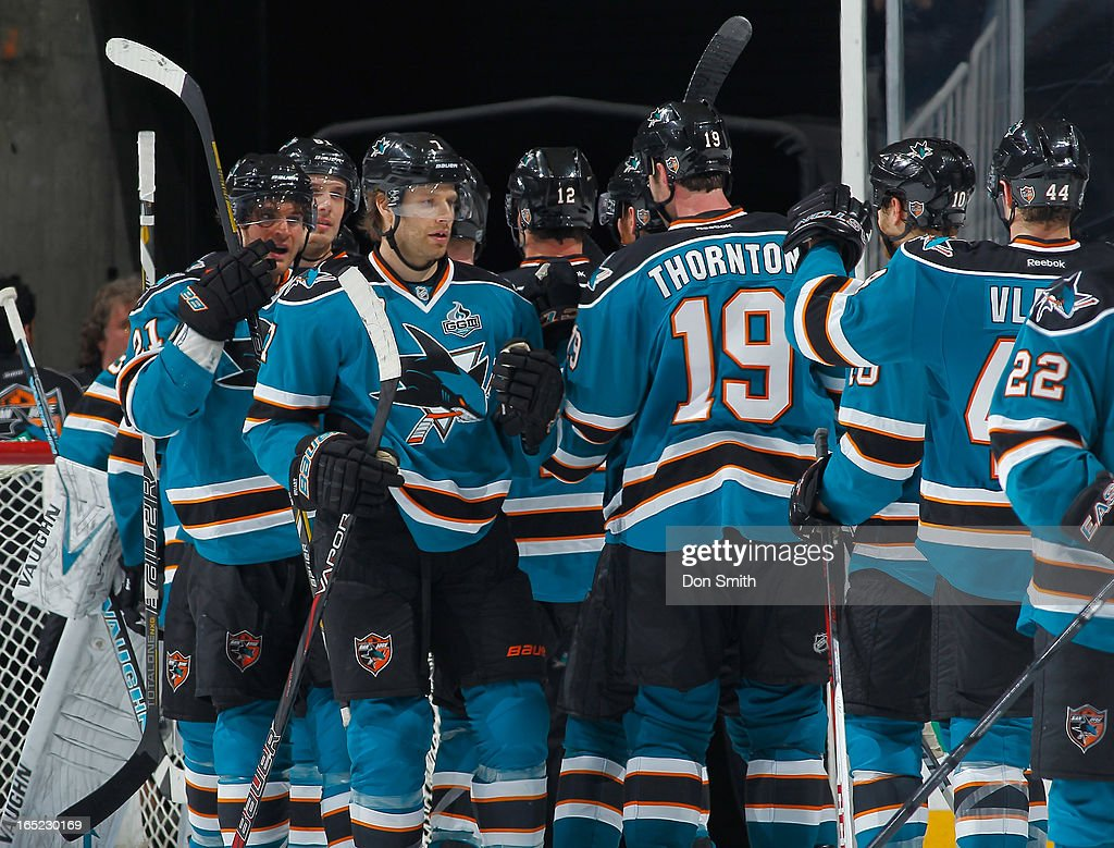 The San Jose Sharks celebrate a victory against the Vancouver Canucks during an NHL game on April 1, 2013 at HP Pavilion in San Jose, California.