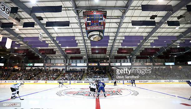 The San Jose Sharks face off against the Vancouver Canucks during Day 3 of NHL Kraft Hockeyville at the Q Centre on September 21 2015 in West Shore...