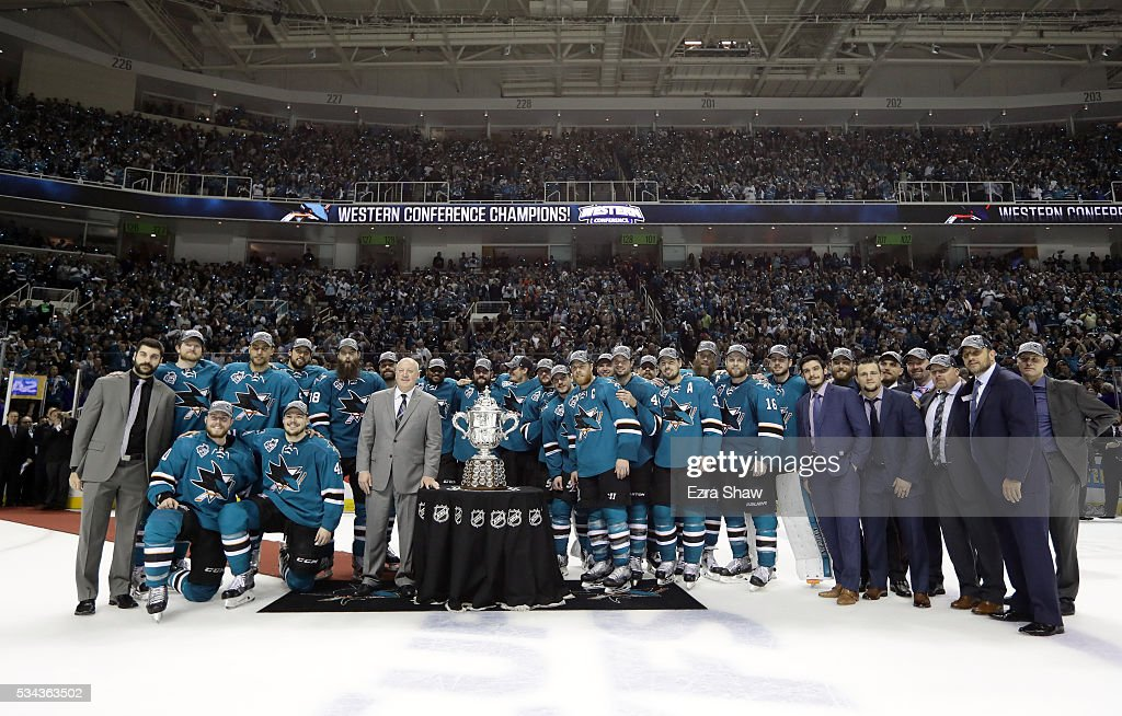 The San Jose Sharks pose with the Clarence S. Campbell Bowl after they were awarded the trophy by NHL Deputy Commissioner Bill Daly for beating the St. Louis Blues in Game Six to win Western Conference Final during the 2016 NHL Stanley Cup Playoffs at SAP Center on May 25, 2016 in San Jose, California.