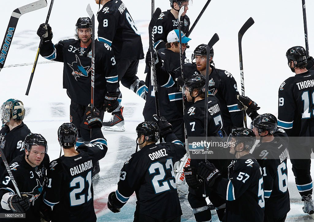 The San Jose Sharks salute the crowd after a victory against the Vancouver Canucks during an NHL game on January 27, 2013 at HP Pavilion in San Jose, California.