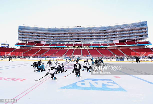The San Jose Sharks stretch at center ice during practice one day prior to the 2015 Coors Light Stadium Series game between the Los Angeles Kings and...
