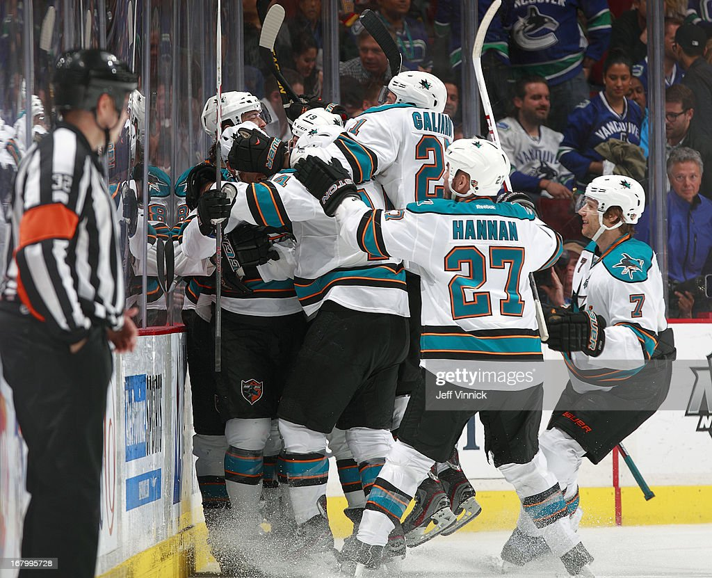 The San Jose Sharks swarm <a gi-track='captionPersonalityLinkClicked' href=/galleries/search?phrase=Raffi+Torres&family=editorial&specificpeople=204612 ng-click='$event.stopPropagation()'>Raffi Torres</a> #13 after he scored the overtime winning goal against the Vancouver Canucks during Game Two of the Western Conference Quarterfinals during the 2013 NHL Stanley Cup Playoffs at Rogers Arena on May 3, 2013 in Vancouver, British Columbia, Canada. San Jose won 3-2 in overtime.