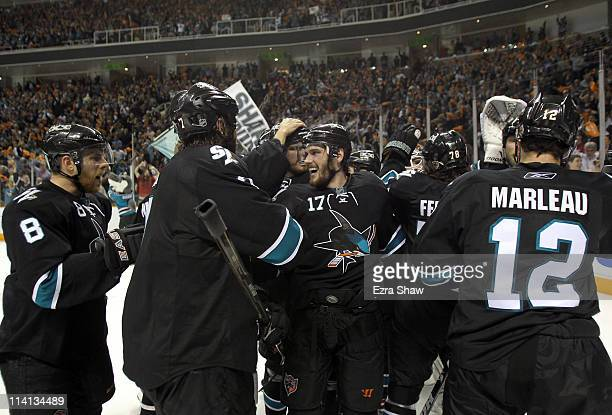 The San Jose Sharks with Torrey Mitchell in the center celebrate after they beat the Detroit Red Wings in Game Seven of the Western Conference...