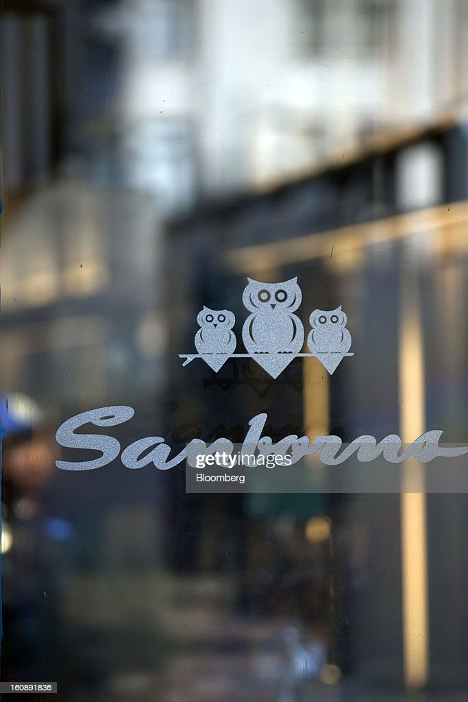 The Sanborns Grupo SAB logo is displayed in a store window in Mexico City, Mexico, on Thursday, Feb. 7, 2013. Billionaire Carlos Slim is taking Mexican retailer Grupo Sanborns SAB public as revenue surges from sales to consumers looking to shop at its Saks Fifth Avenue stores and buy Apple Inc. iPads. Photographer: Susana Gonzalez/Bloomberg via Getty Images