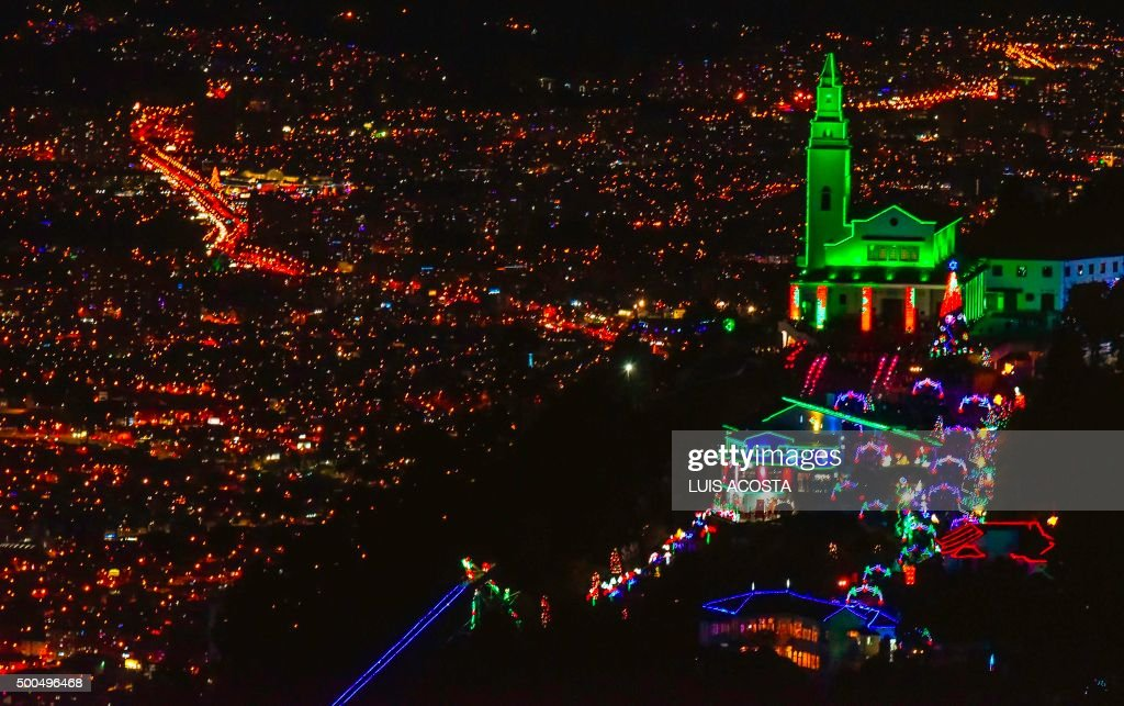 The sanctuary of the Basilica of the Fallen Lord of Montserrate is seen illuminated for Christmas in Bogota on December 8, 2015