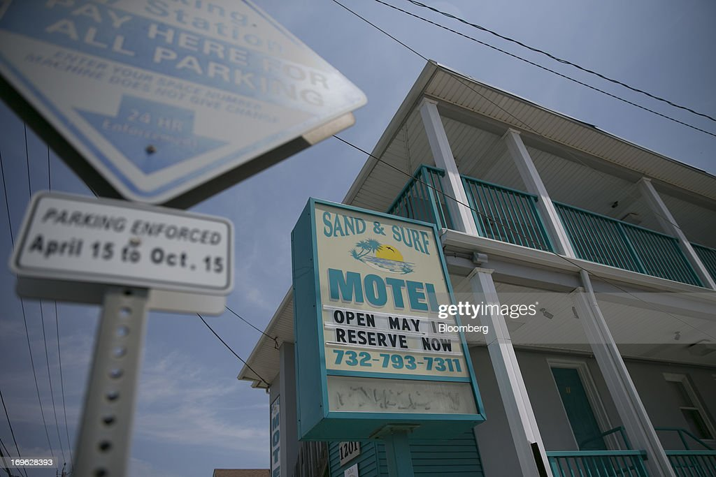 The Sand and Surf Motel stands open for business in Seaside Heights, New Jersey, U.S., on Wednesday, May 29, 2013. Sandy, which came ashore near Atlantic City, killed dozens of people and destroyed more than 365,000 homes in the state. Christie has said it will cost $36.9 billion for repairs and to prevent devastation from future storms. Photographer: Scott Eells/Bloomberg via Getty Images