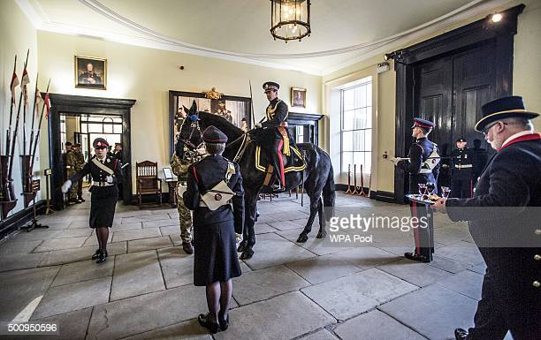 The Sandhurst adjutant Major Peter Middlemiss rides his horse 'Coldstream' into the academy at the traditional closure of the Sovereigns parade in...