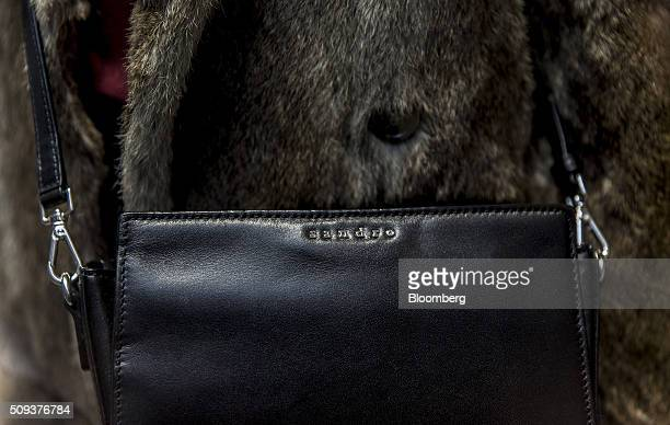 The Sandro logo sits embossed on a leather handbag inside a Sandro luxury clothing store operated by SMCP Group in Toulouse France on Wednesday Feb...