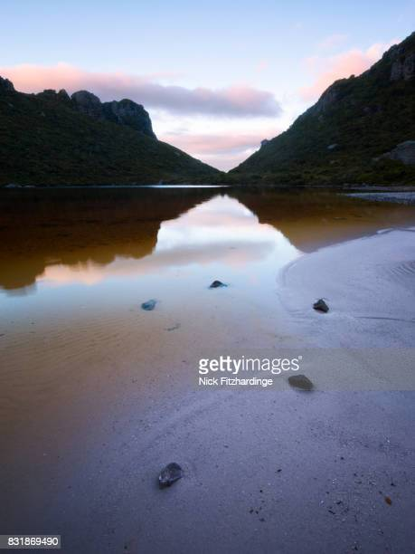 The sandy shores of Lake Cygnus, Southwest National Park, Tasmania, Australia