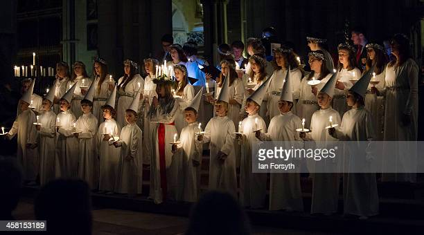 The Sankta Lucia festival of light choir sing during the service at York Minster on December 19 2013 in York England The Swedish tradition of Sankta...